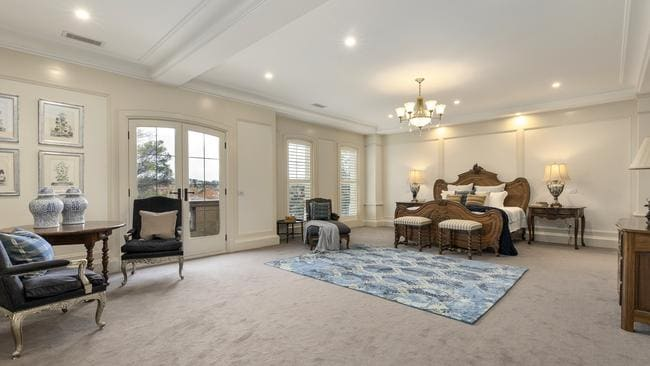 The palatial main bedroom is one of six bedrooms in the house.