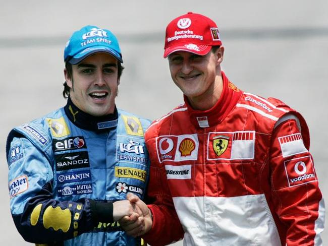 Fernando Alonso and Michael Schumacher prior to the start of the Brazilian F1 Grand Prix at the Interlagos racetrack in Sao Paulo, Brazil Sunday, Oct. 22, 2006. (AP Photos/Victor R. Caivano)