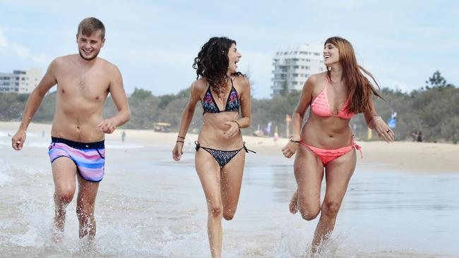 Foreign tourists Tanya Zollino from France (far right), Zack Williams from the UK and Marta Carrion from Spain enjoy the beach at Mooloolaba. Picture: Lachie Millard