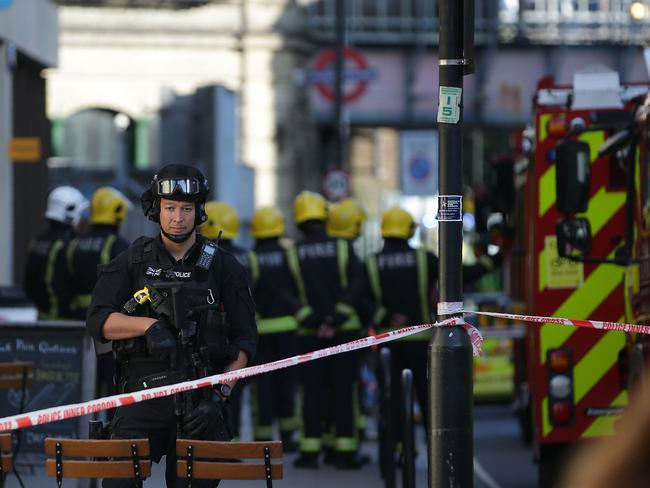 Armed British police officers stand on duty outside Parsons Green underground tube station. Picture: AFP