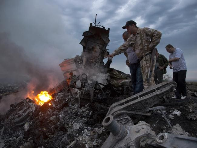 The world was shocked when a Malaysian Airlines plane was shot down in a field in eastern Ukraine in July. Picture: AP / Dmitry Lovetsky