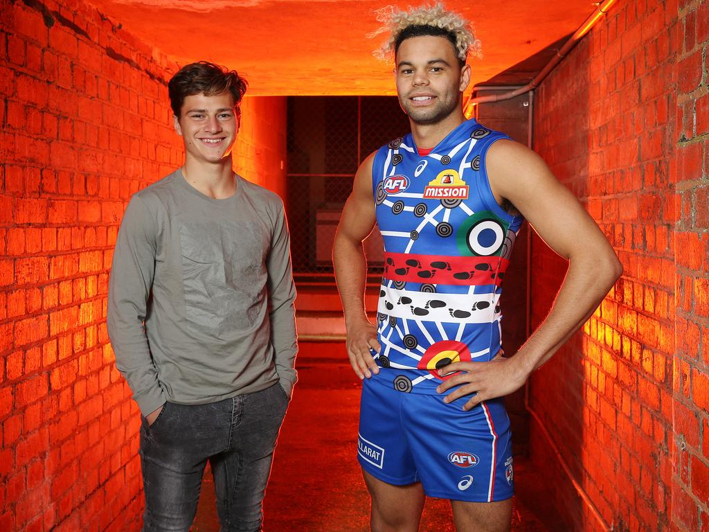 Western Bulldogs speedster Jason Johannisen models the Dogs' 2018 Indigenous jumper which was designed by 16 year old Cooper Craig-Peters. Photo: Michael Klein