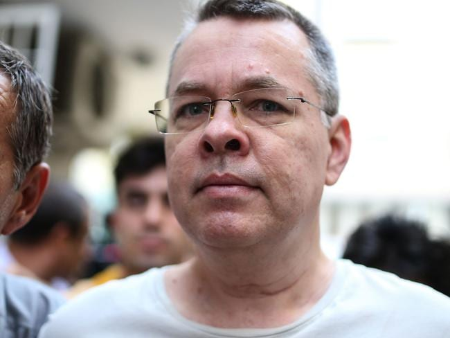 US pastor Andrew Brunson escorted by Turkish plain clothes police officers. Picture: AFP