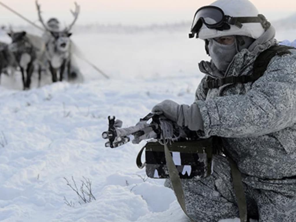 Russian troops, and their reindeer-pulled sled, practice under Arctic conditions. Picture: MoD