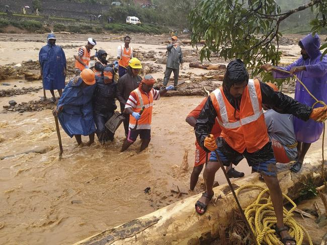 National Disaster Response Force (NDRF) personnel help move flood victims to safer areas in Wayanad district, in the southern Indian state of Kerala. Picture: NDRF via AP