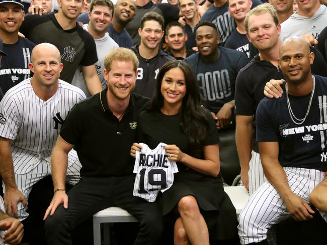 Harry and Meghan with the New York Yankees and their gift to baby Archie. Picture: Getty Images