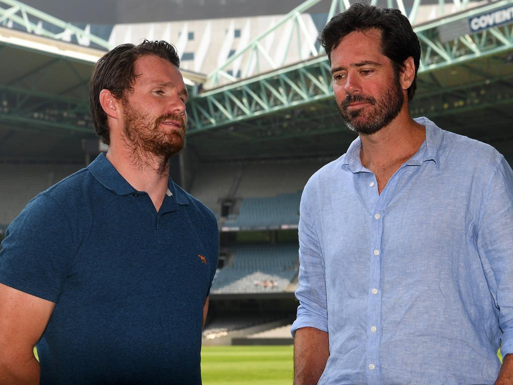AFLPA President Patrick Dangerfield (left) and AFL CEO Gillon McLachlan talk following a press conference at Marvel Stadium, Melbourne, Thursday, January 9, 2019. AFL CEO Gillon McLachlan, AFLPA CEO Paul Marsh and AFLPA President Patrick Dangerfield have announce an AFL state of origin match to raise funds for bushfire affected communities. (AAP Image/James Ross) NO ARCHIVING