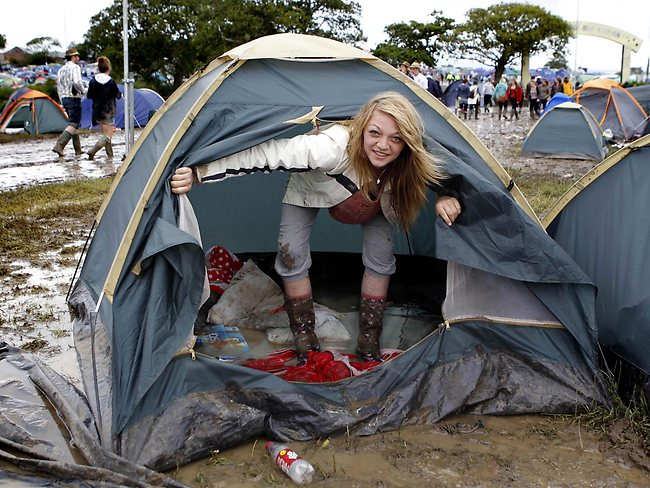 Heavy rains turned the Isle of Wright Festival into a mudbath as Britain enjoyed its wettest June in a century.