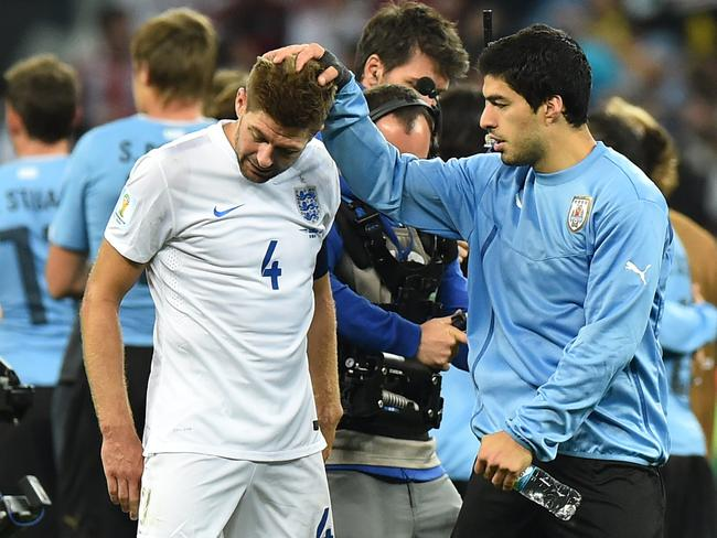 England's Steven Gerrard (L) is consoled by Uruguay's Luis Suarez after his team's win.
