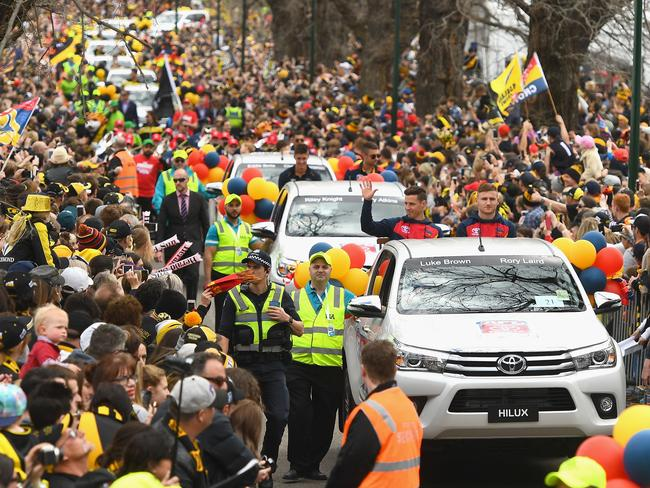 Adelaide players enjoy the Grand Final Parade. (Photo by Quinn Rooney/Getty Images)