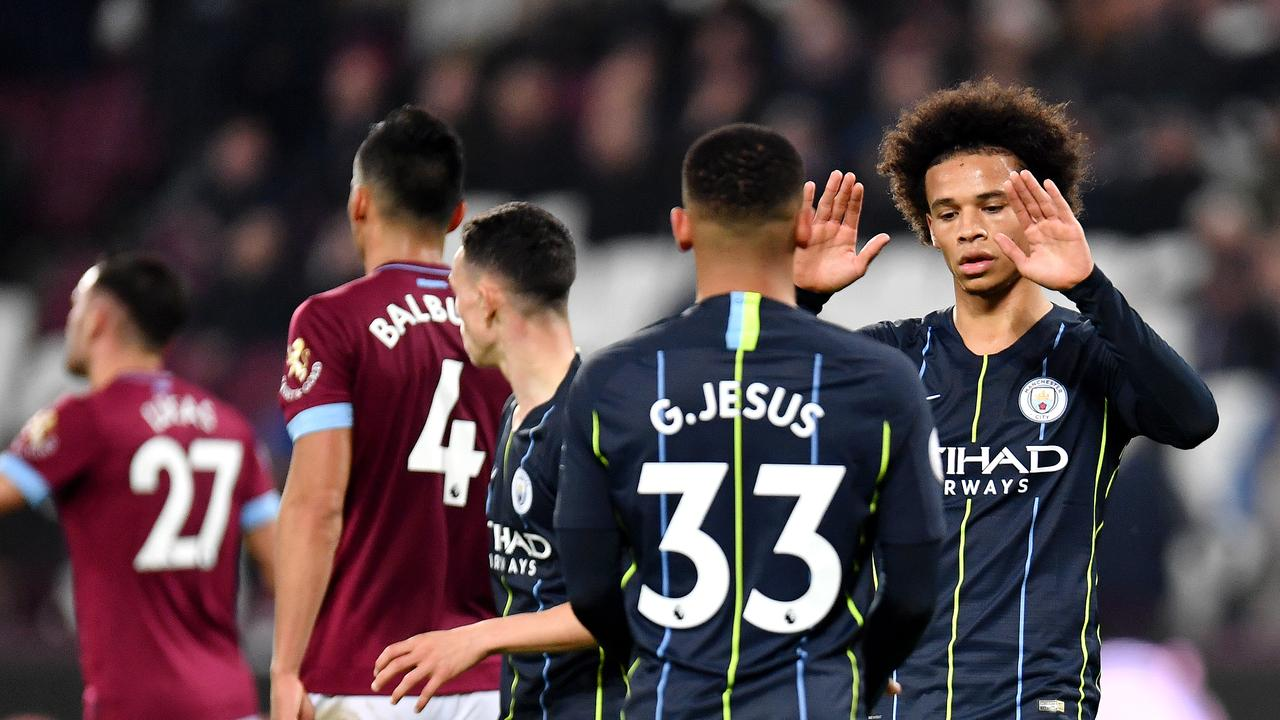 Leroy Sane of Manchester City celebrates with teammates after scoring his team's fourth goal