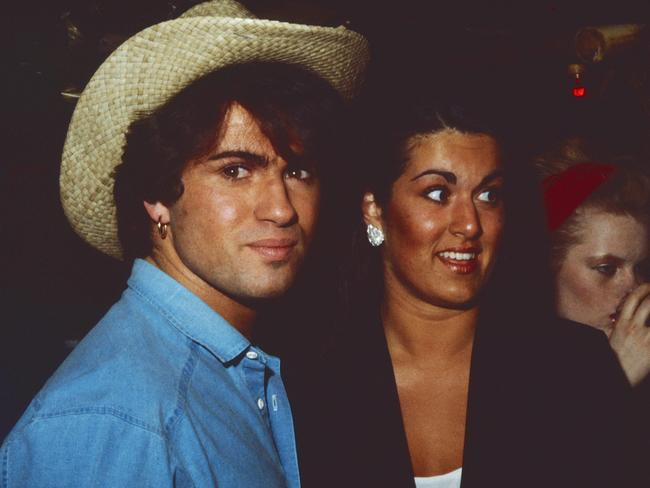 George Michael with sister Melanie Panayiotou at a party in the early 1980s. Picture: PIP-Landmark Media/Alamy