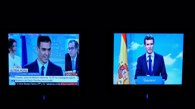 Two screens show a news broadcast about Spanish PM Pedro Sanchez's (L) call for snap elections and a live broadcast by Spanish People's Party (PP) president Pablo Casado (R) in Madrid. Picture: Gabriel Bouys