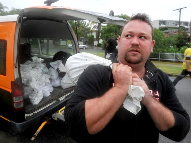 Rain arrives in Brisbane as Tropical Cyclone Marcia hits. Joel Nicolosi collects sandbags at the Morningside SES and is concerned that his home and business in Wakerley may flood. Photograph; Renae Droop.
