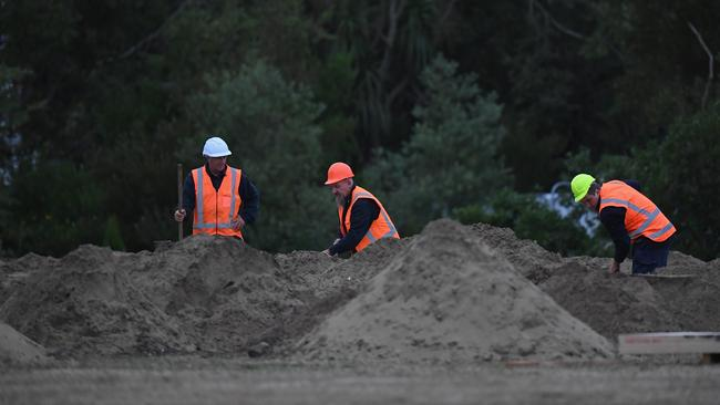 Families have faced an agonising wait as New Zealand authorities have struggled to deal with identifying the bodies of victims. Picture: Kai Schwoerer