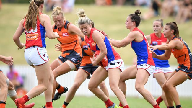 Melbourne's Brooke Patterson in traffic against the Giants. Picture: AAP