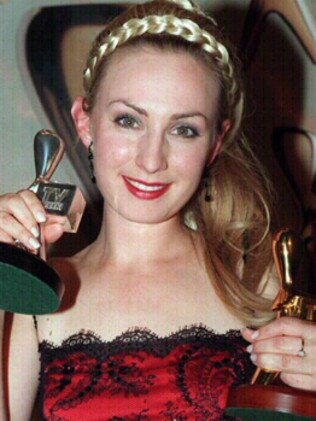Gold and silver Logies ... Lisa McCune at the 1998 awards. Picture: Craig Hughes