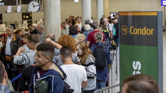 Passengers wait for information at the Condor counter in Frankfurt, Germany. Picture: AP Photo/Michael Probst