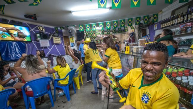 Brazilian fans watch against Colombia in a favela called Algomerado da Serra.
