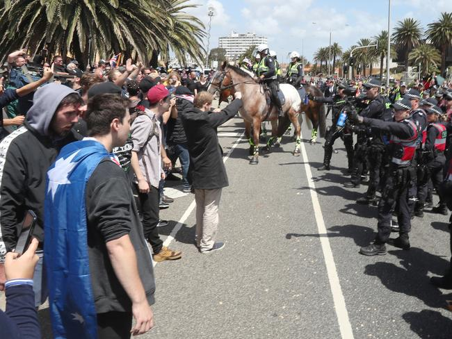 Mounted police kept protesters apart on the St Kilda foreshore on Saturday. Picture: David Crosling/AAP