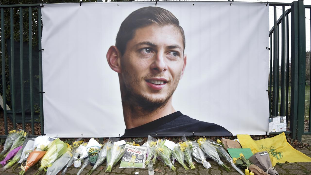 Flowers and tributes are placed near a giant picture of Argentine soccer player Emiliano Sala outside the FC Nantes training camp.