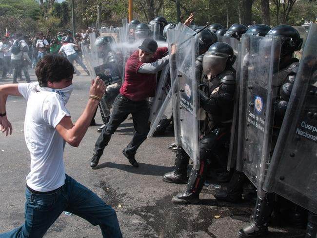 Protesters clash National Bolivarian Guard members during the anti-government protests in Caracas, Venezuela on March 12, 2014. Pic: Cristian Hernandez.