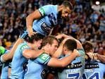 James Tedesco of the Blues is congratulated by team mates after scoring a try during game three of the State of Origin series between the Queensland Maroons and the New South Wales Blues at Suncorp Stadium on July 11, 2018 in . (Photo by Bradley Kanaris/Getty Images)