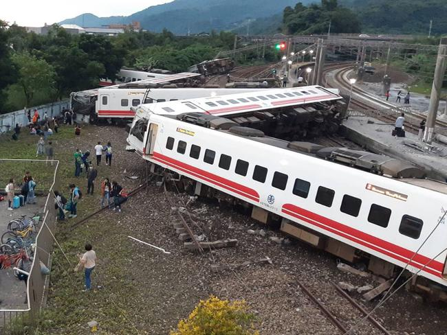 A derailed train in Yian, eastern Taiwan killing at least 18 people and injuring hundreds. Picture: AFP