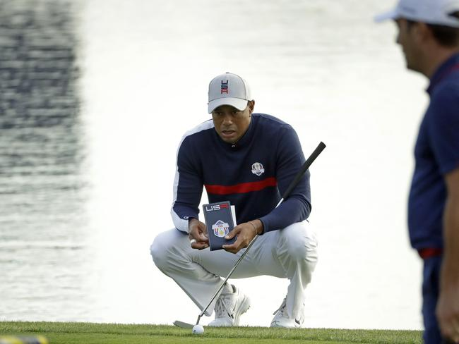 Tiger Woods lines up a shot on the first hole during the Ryder Cup in France.