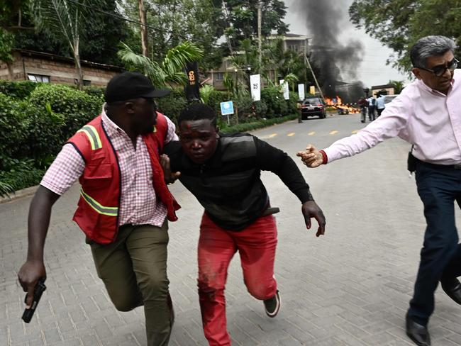 An injured man is evacuated from the scene of an explosion at a hotel complex in Nairobi's Westlands suburb. Picture: AFP