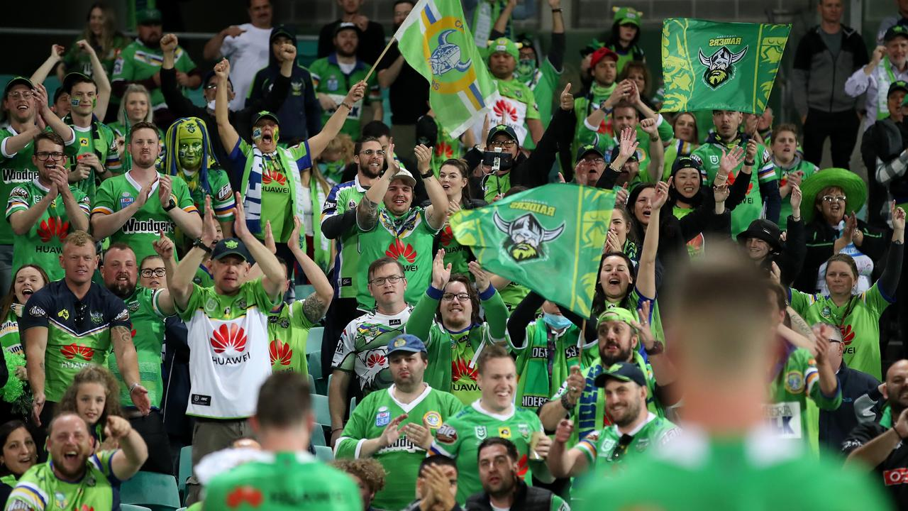 Raiders fans celebrate after beating the Roosters at the SCG.
