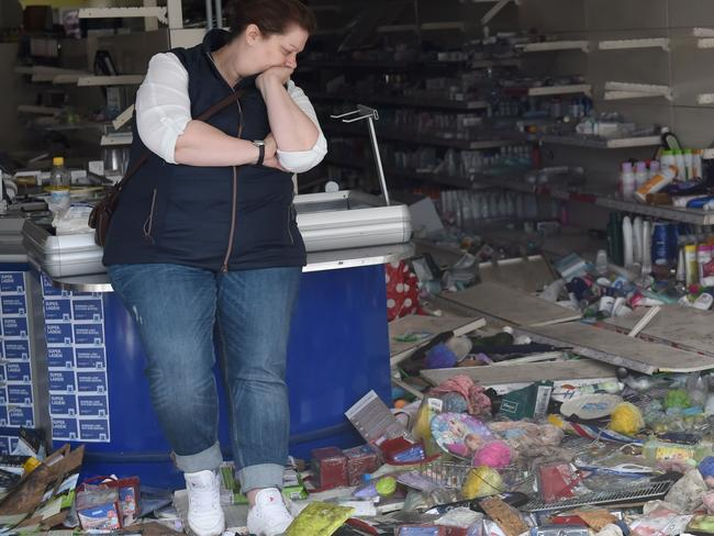 A woman stands in her looted store after the G20 protests turned violent in Hamburg. Picture: AFP PHOTO / Christof STACHE