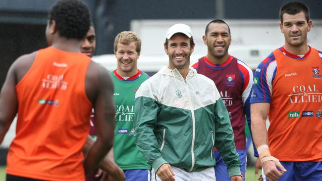 Andrew Johns directs players during a Knights training session.