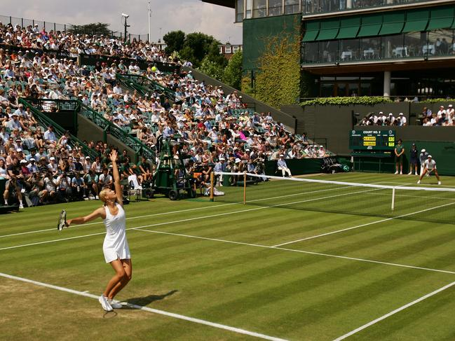 Maria Sharapova serves to Ashley Harkleroad during their match at Wimbledon in 2003.