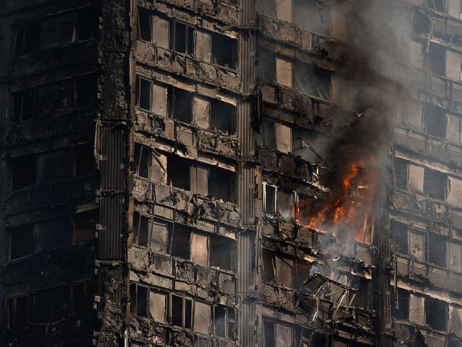 Debris falls from the burning 24-storey residential tower block. Picture: Chris J Ratcliffe/Getty Images