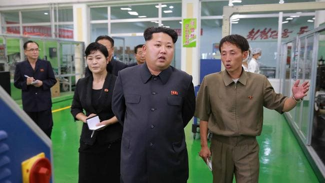 This undated picture released from North Korea's official Korean Central News Agency (KCNA) on July 14, 2015 shows North Korean leader Kim Jong-un inspecting the Rangnang sanitary goods factory.