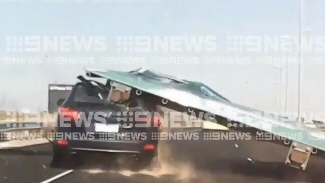 The moment a sign fell on a car on the Tullamarine Freeway. Picture: 9 News Melbourne