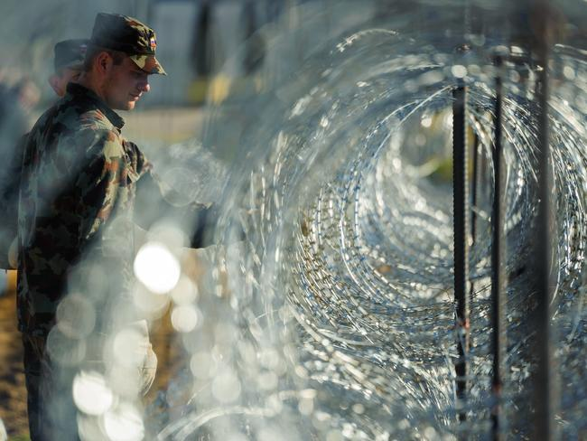 Migrants blocked ... Slovenia's army has begun rolling out razor wire along the border with Croatia.