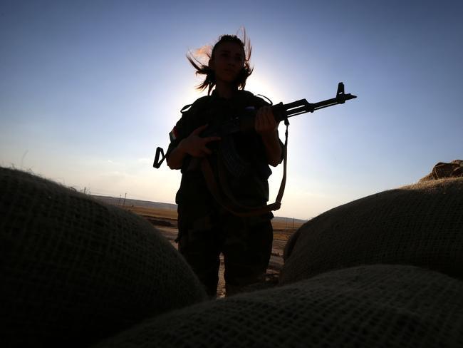 An Iranian Kurdish fighter holds position near Kirkuk in September against ISIS militants. Pic: AFP PHOTO/SAFIN HAMED