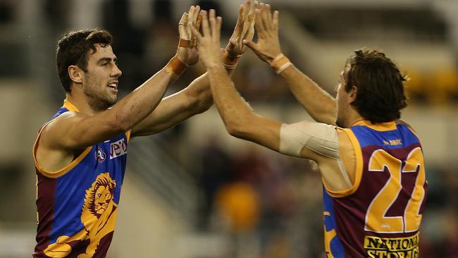 Michael Close and Marco Paparone celebrate a goal. Picture: Jono Searle.
