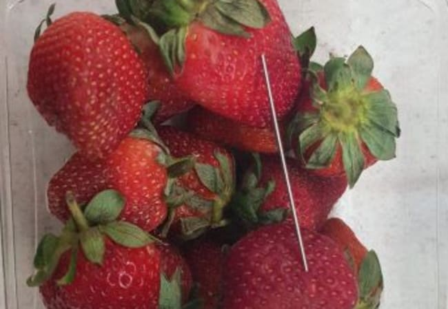 The punnet from Coles Gatton found with a needle on top of the strawberries. Picture: Queensland Police Service