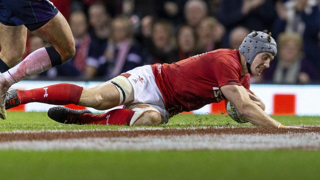 Wales centre Jonathan Davies scores a try against Scotland at The Principality Stadium.