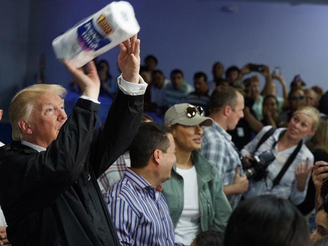 US President Donald Trump tosses paper towels into a crowd at Calvary Chapel in Guaynabo, Puerto Rico. Picture: AP
