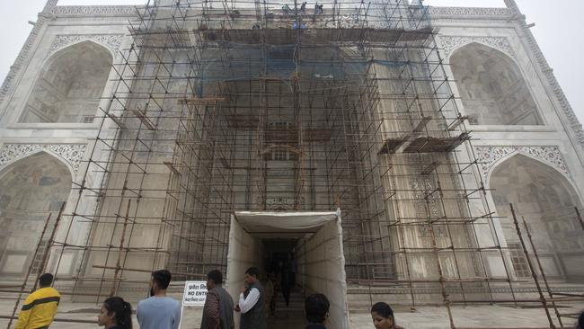 Workers clean discolouration on the Taj Mahal caused by environmental pollution. Picture: AP/Manish Swarup