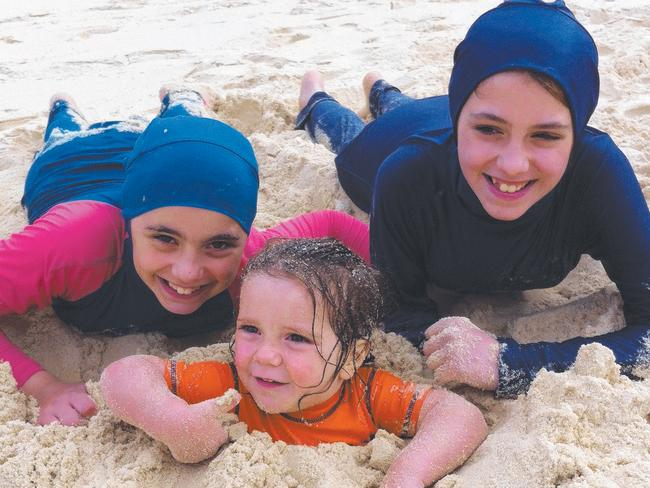 Hoda, Humzeh and Zaynab on Avoca Beach in 2012 before they were taken to Syria.