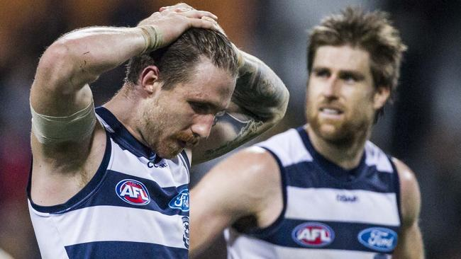 Geelong players react to the loss to West Coast. (AAP Image/Tony McDonough)