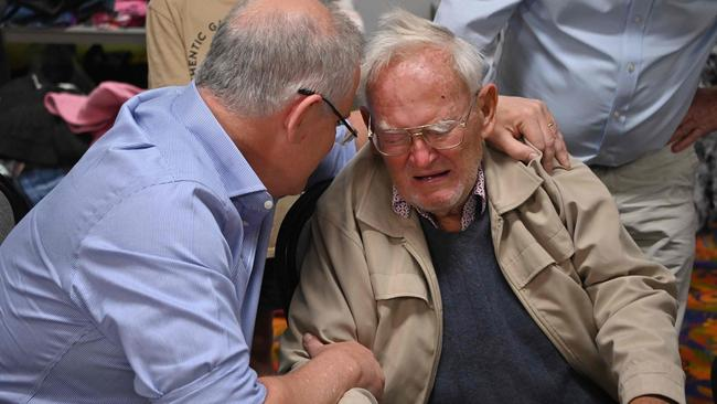 Prime Minister Scott Morrison comforts 85-year-old resident Owen Whalan at an evacauation centre in Taree, 350km north of Sydney. Picture: Peter Parks