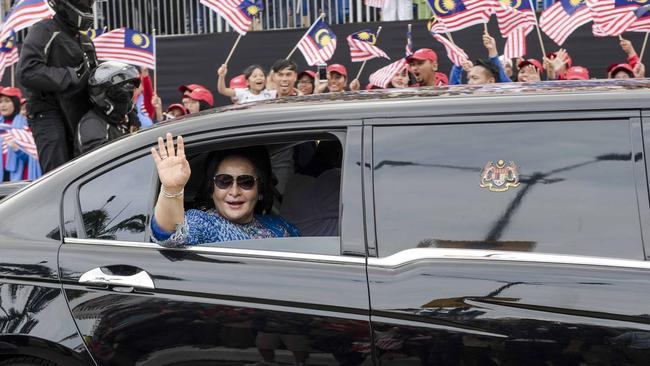Rosmah Mansor waves from a state limousine in Kuala Lumpur. Picture: Chris Jung.
