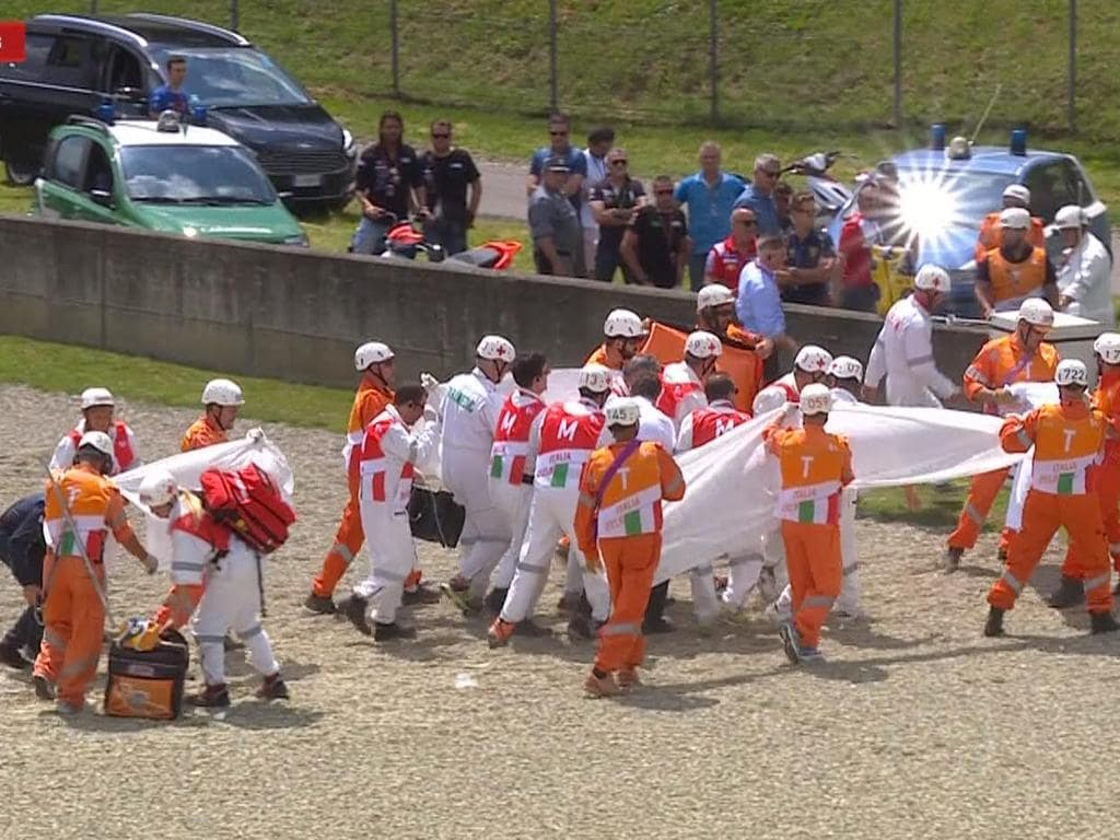 Michele Pirro is carried off the track after his crash.