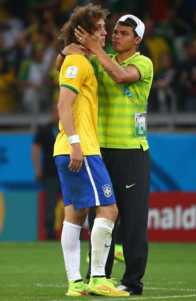 Brazil's suspended captain, Thiago Silva, consoles the team's stand-in captain, David Luiz.